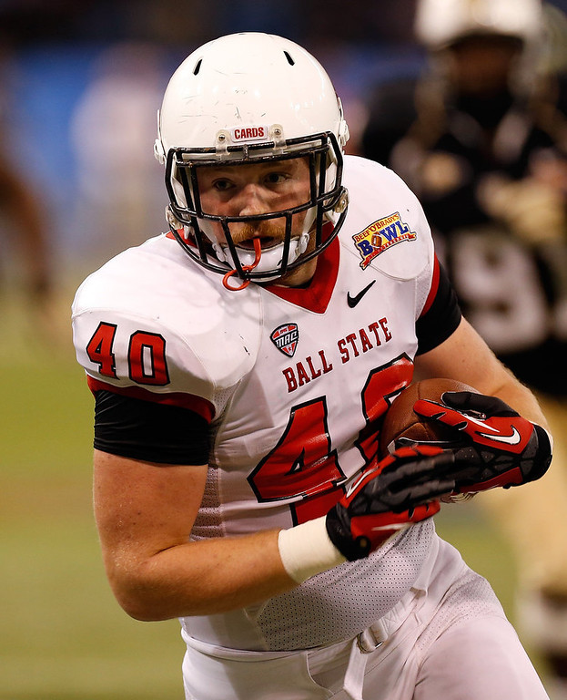 . Tightend Dylan Curry #40 of the Ball State Cardinals runs after a catch against the Central Florida Knights during the Beef \'O\' Brady\'s St Petersburg Bowl Game at Tropicana Field on December 21, 2012 in St Petersburg, Florida.  (Photo by J. Meric/Getty Images)