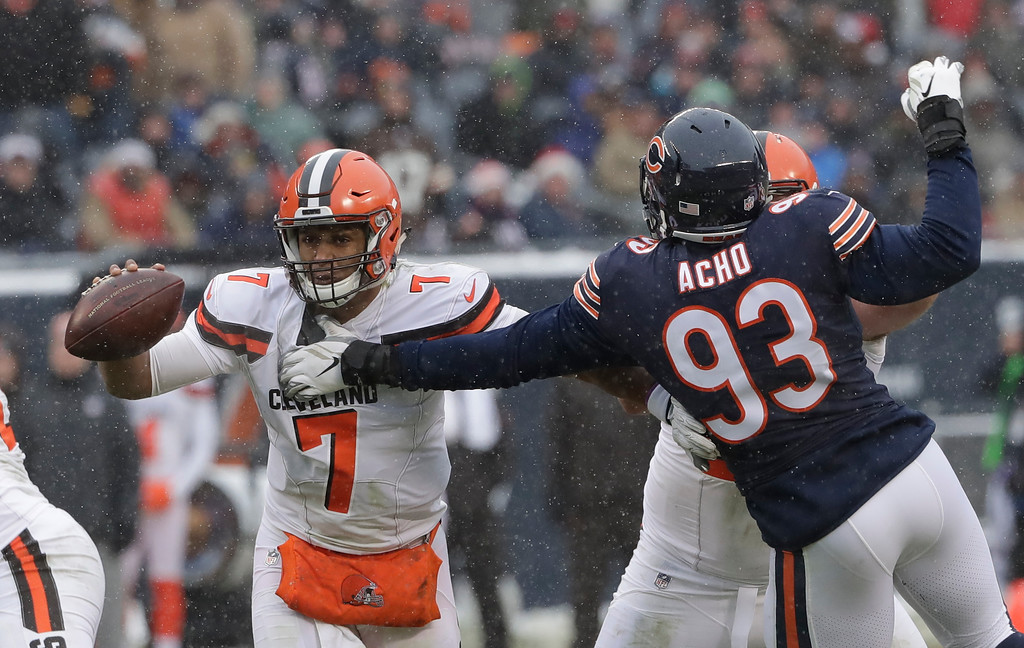 . Chicago Bears outside linebacker Sam Acho (93) applies pressure to Cleveland Browns quarterback DeShone Kizer (7) in the second half of an NFL football game in Chicago, Sunday, Dec. 24, 2017. (AP Photo/Nam Y. Huh)