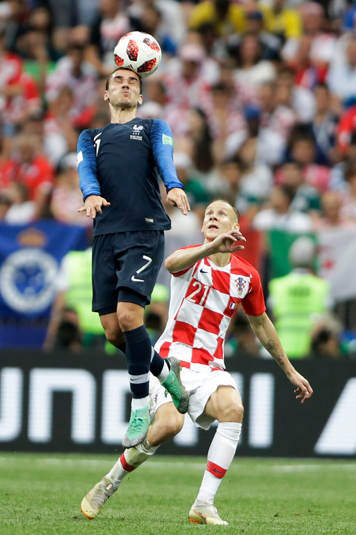 . France\'s Antoine Griezmann heads the ball under the watch of Croatia\'s Domagoj Vida during the final match between France and Croatia at the 2018 soccer World Cup in the Luzhniki Stadium in Moscow, Russia, Sunday, July 15, 2018. (AP Photo/Natacha Pisarenko)