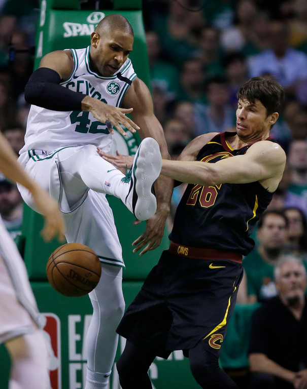 . Boston Celtics forward Al Horford (42) and Cleveland Cavaliers guard Kyle Korver (26) compete for a loose ball during the second quarter of Game 5 of the NBA basketball Eastern Conference finals Wednesday, May 23, 2018, in Boston. (AP Photo/Charles Krupa)