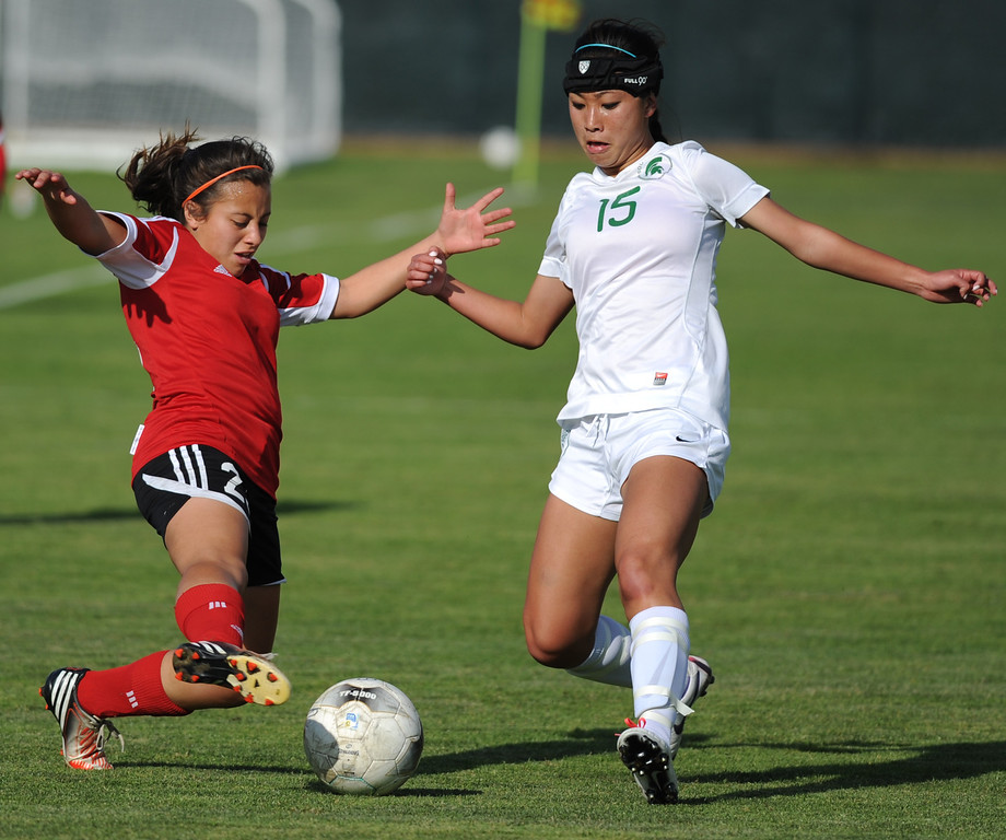 . 02-21-2012--(LANG Staff Photo by Sean Hiller)- South Torrance girls soccer beat Artesia 5-0 in Thursday\'s CIF Southern Section Division IV quarterfinal at South High. Artesia\'s Diana Mota (23),left, battles South\'s Noelle Ly (15).