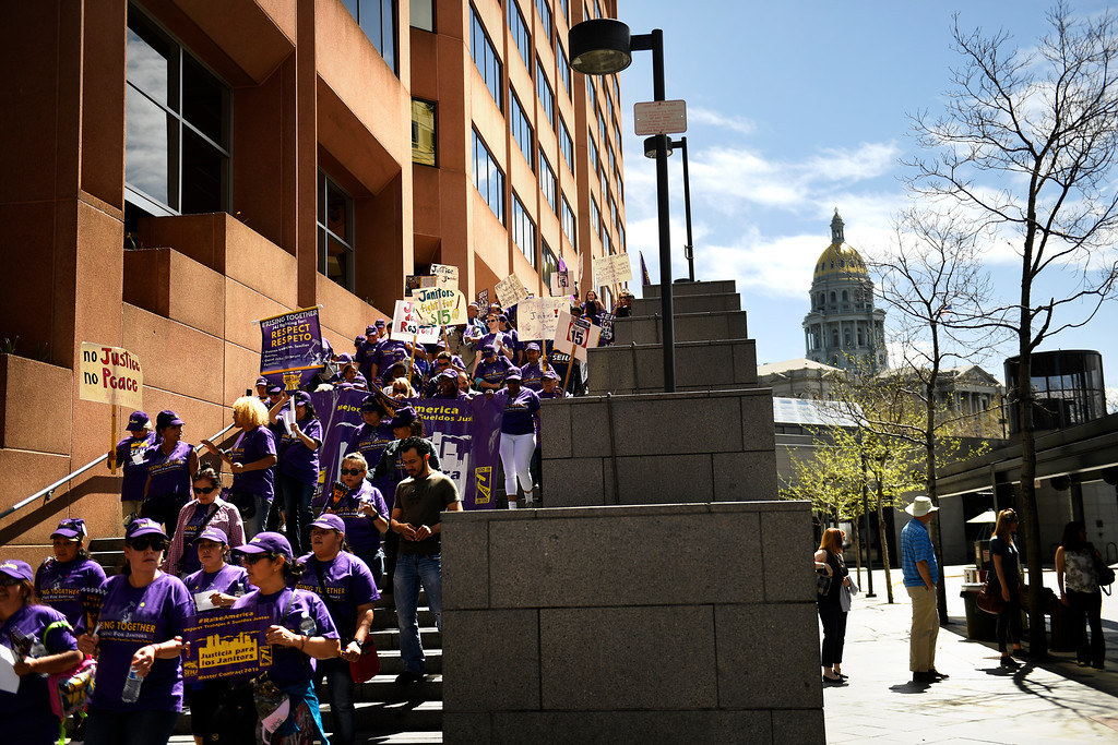 . Denver, CO - ARRIL 14: Denver�s low wage janitors kick off their contract campaign with a rally at Civic Center Park�s Veterans Memorial in downtown and a march past all the buildings where they do their work in Denver. The janitors were joined by local care workers, Fast food, delivery persons and service workers during their  Underpaid Fight for $15 march. April 14, 2016 in Denver, CO. (Photo By Joe Amon/The Denver Post)