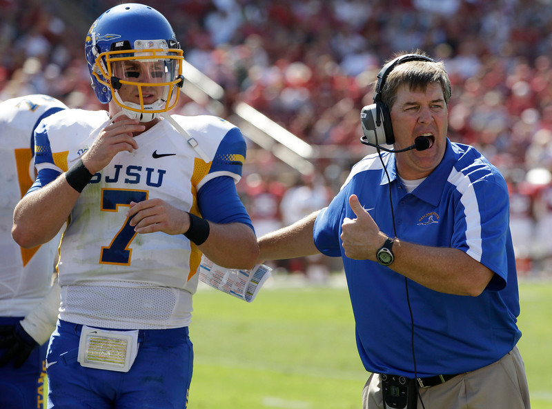 . San Jose State head coach Mike MacIntyre, right, talks with quarterback Matt Faulkner (7) in the second quarter of an NCAA college football game against Stanford, Saturday, Sept. 3, 2011, in Stanford, Calif. (AP Photo/Paul Sakuma)