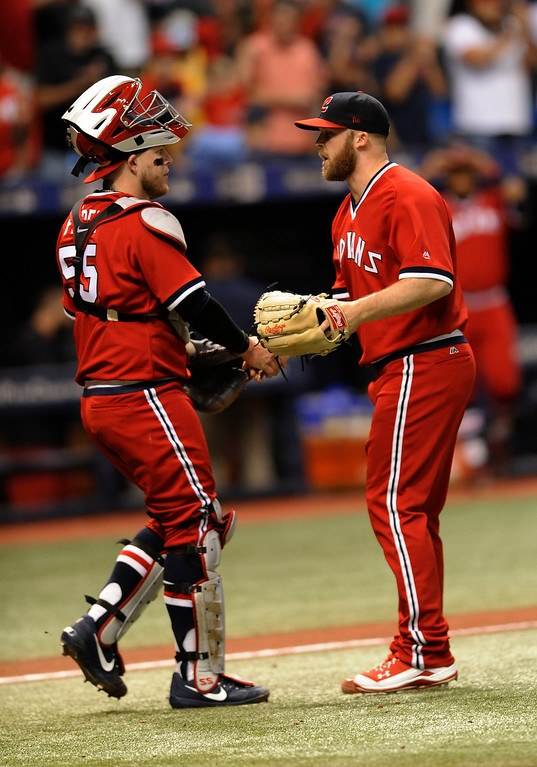 . Cleveland Indians catcher Roberto Perez and reliever Cody Allen, right, celebrate the team\'s 3-0 win over the Tampa Bay Rays in a baseball game Saturday, Aug. 12, 2017, in St. Petersburg, Fla. (AP Photo/Steve Nesius)