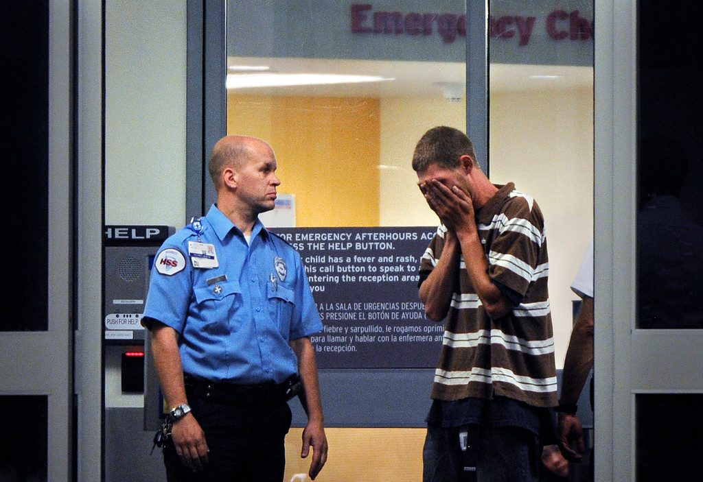 . Ian Sullivan is overcome with emotion as he arrives at Children\'s Hospital in Aurora, Colo. frantically searching for his daughter and his ex-wife. Six hours later he would learn that his daughter, Veronica Moser-Sullivan, 6, was one of the twelve victims killed in the mass shooting at the midnight premiere of the latest Batman movie and his ex-wife, Ashley, was paralyzed after being shot in the neck and stomach. Craig F. Walker, The Denver Post