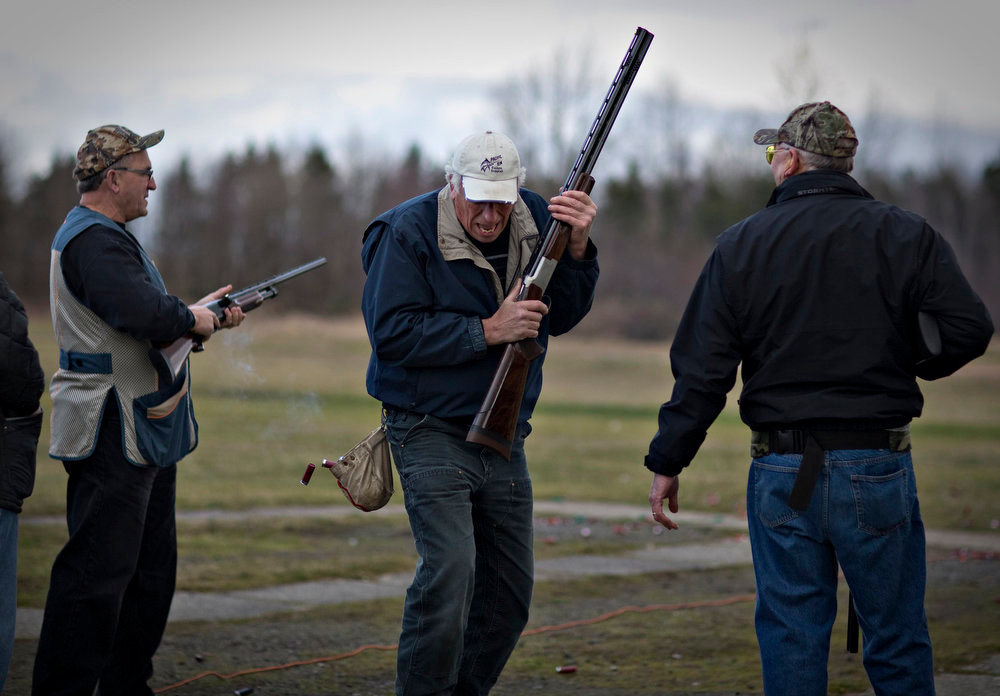 . Shooter Doug Boyd reacts after he hits his trap at the Vancouver Gun Club in Richmond, British Columbia February 17, 2013. The club offers trap, skeet, sporting clays and Olympic trap for members and day visitors. Formed in 1924 the Vancouver Gun Club, which is a shotgun-only club, has a regular membership of about 400 and sells an estimated 1100 day passes each year. Canada has very strict laws controlling the use of handguns and violent crime is relatively rare. Picture taken February 17, 2013.   REUTERS/Andy Clark