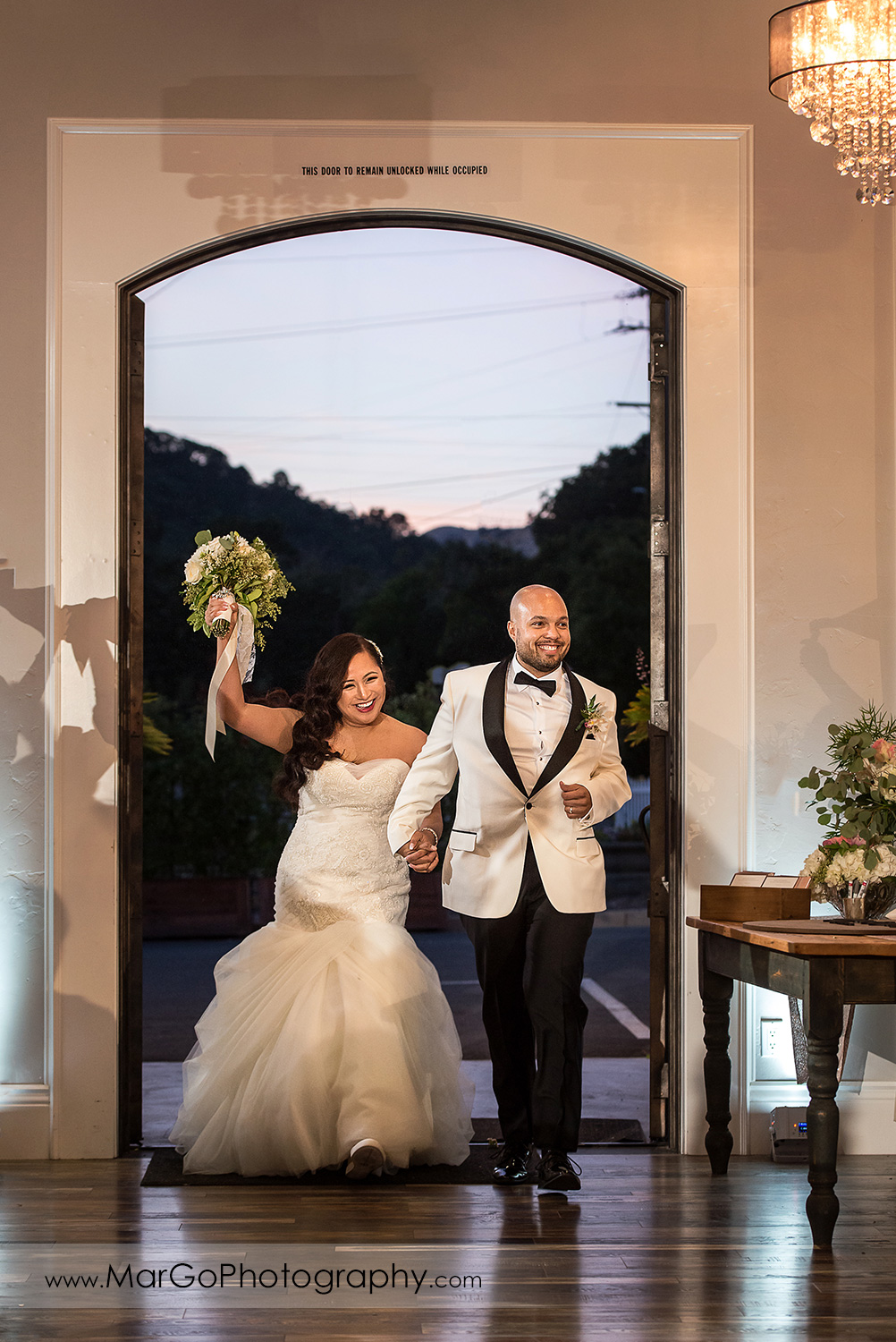 grand entrance - bride and groom walking into reception site at Sunol's Casa Bella