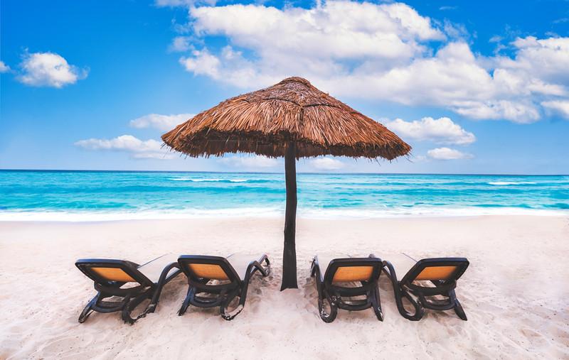 Beach umbrella near the blue ocean