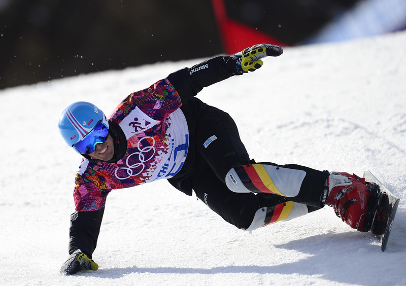 . Germany\'s Patrick Bussler competes in the Men\'s Snowboard Parallel Giant Slalom Final at the Rosa Khutor Extreme Park during the Sochi Winter Olympics on February 19, 2014.  JAVIER SORIANO/AFP/Getty Images