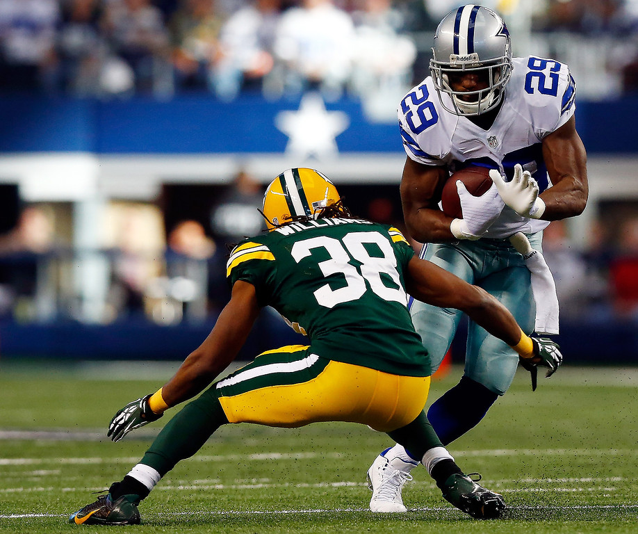 . Running back DeMarco Murray #29 of the Dallas Cowboys carries the ball as cornerback Tramon Williams #38 of the Green Bay Packers defends during a game at AT&T Stadium on December 15, 2013 in Arlington, Texas.  (Photo by Tom Pennington/Getty Images)