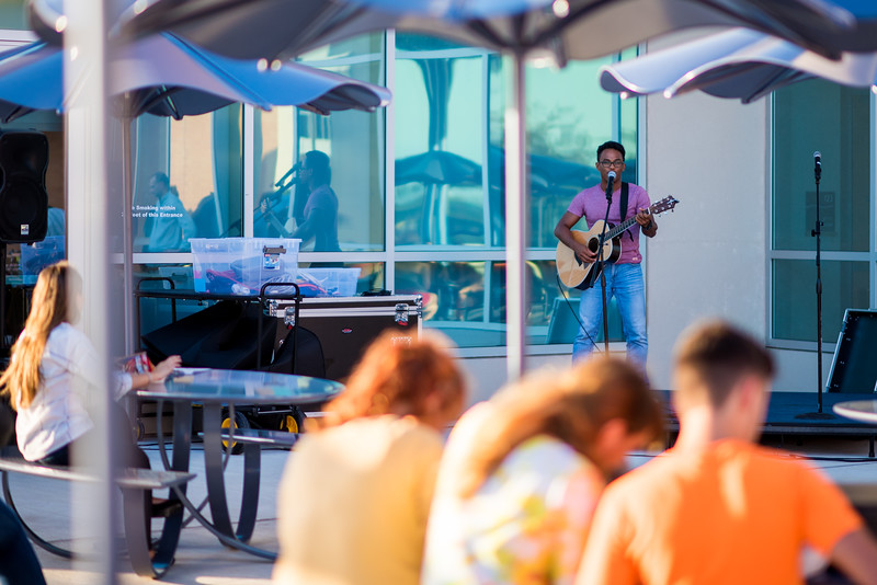 Antony Lametrie performs for Islanders at the University Center's south entrance patio, during the Patio Jame event.