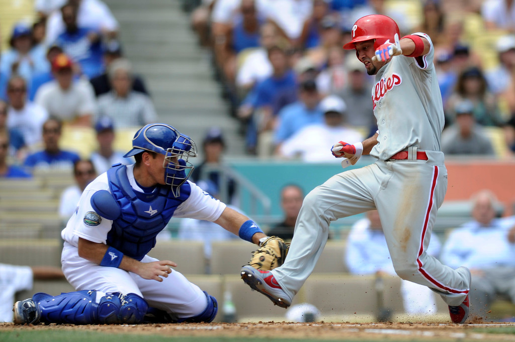 . The Phillies\' Shave Victorino avoids the tag of Dodgers catcher A.J. Ellis to score from second on a hit by Carlos Ruiz in the fourth inning, Wednesday, July 18, 2012, at Dodger Stadium. (Michael Owen Baker/Staff Photographer)
