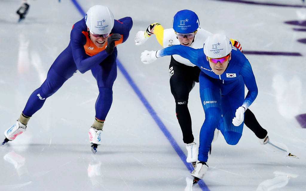. Gold medalist Lee Seung-hoon of South Korea, leading, silver medalist Bart Swings of Belgium, center, and bronze medalist Koen Verweij of The Netherlands, left, sprint towards the finish line during the men\'s mass start final speedskating race at the Gangneung Oval at the 2018 Winter Olympics in Gangneung, South Korea, Saturday, Feb. 24, 2018. (AP Photo/Vadim Ghirda)