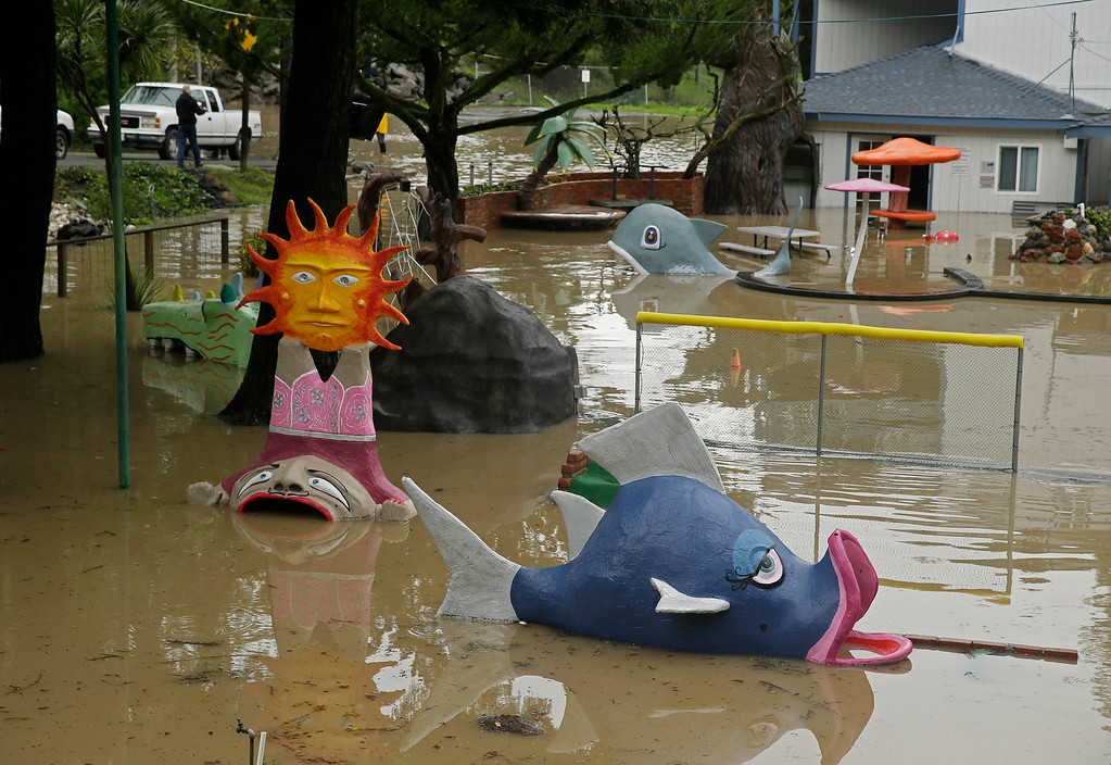 . Water from the Russian River floods an amusement park Friday, Dec. 12, 2014, in Guerneville, Calif. While the sun rose Friday in a dry San Francisco sky, the storm\'s affects lingered in Northern California. In Sonoma County, the Russian River was approaching flood stage and was expected to crest several feet above it by early afternoon. Officials advised residents of about 300 homes to evacuate low-lying areas. (AP Photo/Eric Risberg)