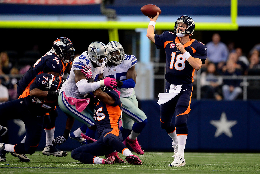 . Peyton Manning (18) of the Denver Broncos fires a pass against the Dallas Cowboys during the first half at AT&T Stadium.  (Photo by AAron Ontiveroz/The Denver Post)