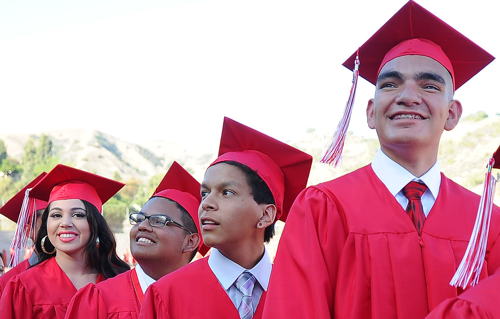 . Students make their way to their seats during the Whittier High School graduation at Whittier College in Whittier, Calif., on Wednesday, June 4, 2014.  (Keith Birmingham/Pasadena Star-News)