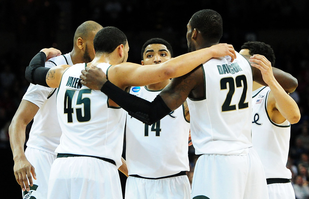 . SPOKANE, WA - MARCH 22:  Gary Harris #14 of the Michigan State Spartans and teammates huddle in the second half against the Harvard Crimson during the Third Round of the 2014 NCAA Basketball Tournament at Spokane Veterans Memorial Arena on March 22, 2014 in Spokane, Washington.  (Photo by Steve Dykes/Getty Images)