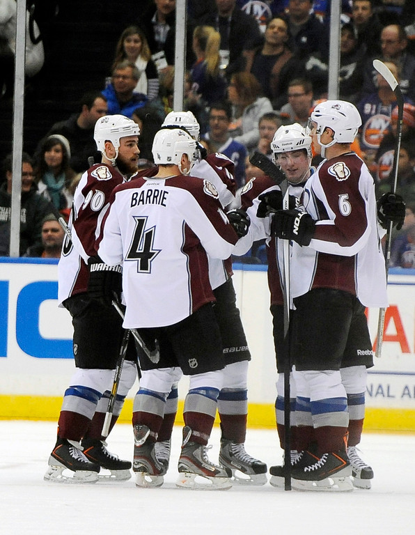 . Colorado Avalanche\'s Ryan O\'Reilly (90), Tyson Barrie (4), Erik Johnson (6) and Matt Duchene (9) celebrate Duchene\'s second goal in the second period of an NHL hockey game against the New York Islanders on Saturday, Feb. 8, 2014, in Uniondale, N.Y. (AP Photo/Kathy Kmonicek)