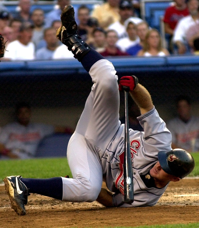 . Cleveland Indians Jim Thome hits the dirt to avoid a pitch by New York Yankees\' David Wells in the third inning Wednesday night, July 3, 2002 at Yankee Stadium in New York.  (AP Photo/Bill Kostroun)