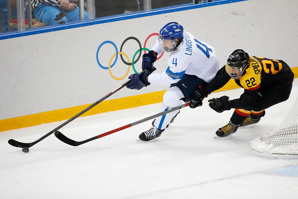 . Kerstin Spielberger of Germany chases Rosa Lindstedt of Finland during the 2014 Winter Olympics women\'s ice hockey game at Shayba Arena, Sunday, Feb. 16, 2014, in Sochi, Russia. (AP Photo/Petr David Josek)