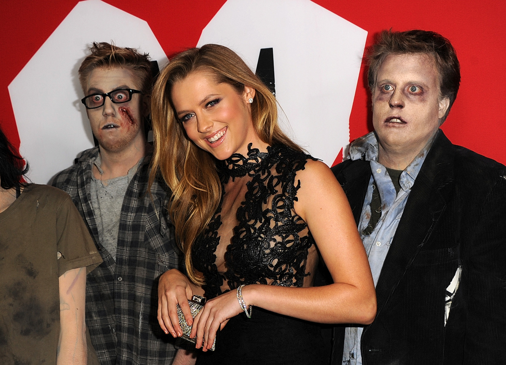 "Description of . Actress Teresa Palmer and zombies arrive for the Los Angeles premiere of Summit Entertainment\'s ""Warm Bodies\"" at ArcLight Cinemas Cinerama Dome on January 29, 2013 in Hollywood, California.  (Photo by Kevin Winter/Getty Images)"