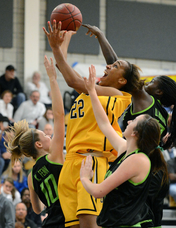 . From left, Miramonte High\'s Kaitlin Fenn (10), Jesse Wilson (21) and Uriah Howard (12) all try to block Bishop O\'Dowd High\'s Oderah Chidom (22) center, from catching a rebound in the forth period of their Division III North Coast Section basketball game in Dublin, Calif., on Saturday, March 2, 2013. Bishop O\'Dowd High went on to win the game 77-48. (Doug Duran/Staff)