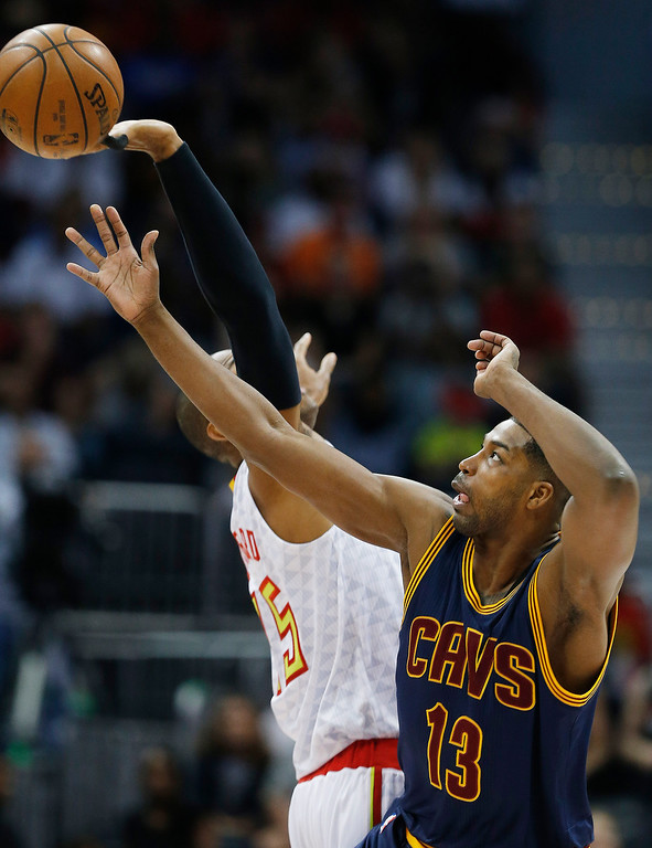 . Cleveland Cavaliers center Tristan Thompson (13) and Atlanta Hawks center Al Horford (15) tip the ball off during Game 4 of the second-round NBA basketball playoff series, Sunday, May 8, 2016, in Atlanta. (AP Photo/John Bazemore)