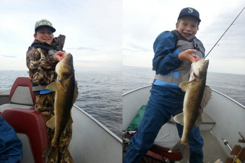 . Jack Longfellow11, left, and Will Longfellow, 9, of Hugo, caught and released these two walleyes on the May 10  opener on Lake Mille Lacs with dad, Bob Longfellow. (Photo courtesy Bob Longfellow)