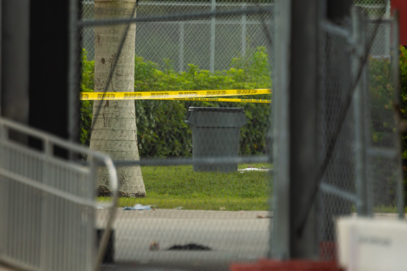 Crime scene tape is stretched around an area near one of the entrances to the Palm Beach Central high school football field after a shooting during a football game on Friday night.  Image captured on Saturday, August 18, 2018. (Joseph Forzano / The Palm Beach Post)