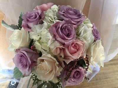 Lavender and pink roses, white hydrangea grey miller $125
