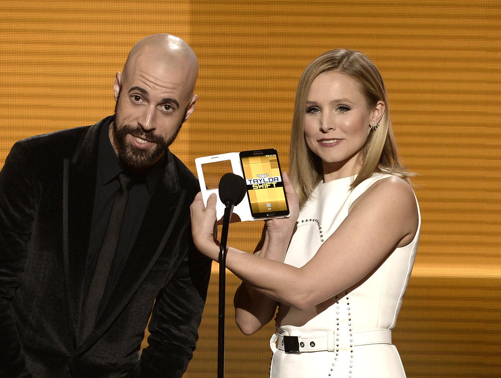. Singer Chris Daughtry and actress Kristen Bell speak onstage during the 2013 American Music Awards at Nokia Theatre L.A. Live on November 24, 2013 in Los Angeles, California.  (Photo by Kevin Winter/Getty Images)