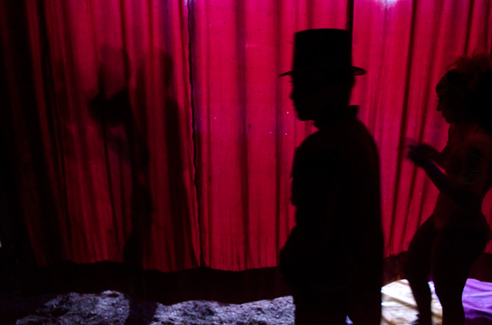 . In this June 25, 2014 photo Alma Orocco, the ringmaster, waits backstage at the Fuentes Gasca Brothers Circus in Mexico City, Wednesday, June 25, 2014. Orocco and hundreds of other circus performers have taken to the streets of Mexico City recently to protest legislation that will ban the use of animals in the circus. The circuses have one year to change their acts or face steep fines. (AP Photo/Sean Havey)
