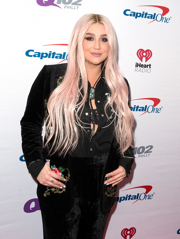 . Kesha poses for photographers backstage during Q102\'s iHeartRadio Jingle Ball 2017 at the Wells Fargo Center on Wednesday, Dec. 6, 2017, in Philadelphia. (Photo by Owen Sweeney/Invision/AP)