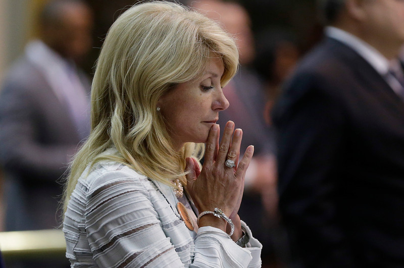 . Sen. Wendy Davis, D-Fort Worth, reacts after she was called for a third and final violation in rules to end her filibuster attempt to kill an abortion bill, Tuesday, June 25, 2013, in Austin, Texas. The bill would ban abortion after 20 weeks of pregnancy and force many clinics that perform the procedure to upgrade their facilities and be classified as ambulatory surgical centers.  (AP Photo/Eric Gay)