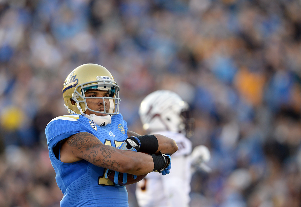 . UCLA�s Devin Lucien #15 reacts after hauling in a first half touchdown pass during their game against Arizona State�s at the Rose Bowl Saturday November 23, 2013. (Photos by Hans Gutknecht/Los Angeles Daily News)