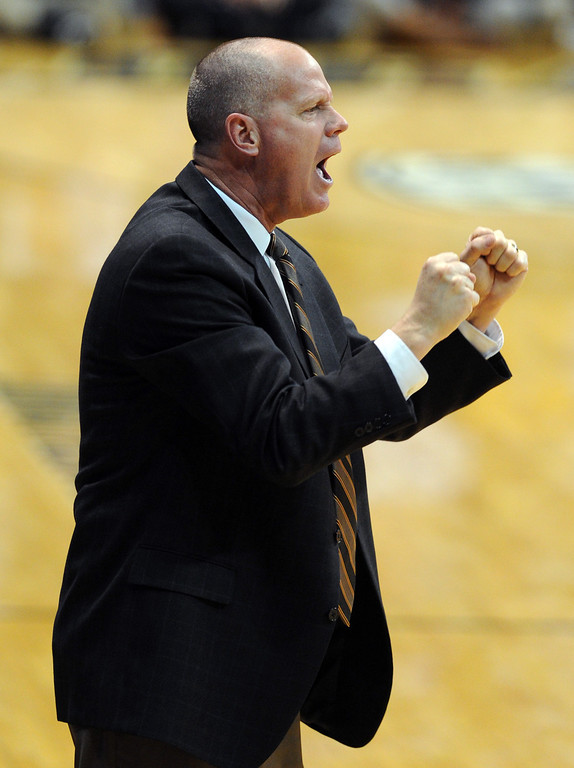 . Colorado coach Tad Boyle encourages his players during the first half of the December 13, 2013 game in Boulder. (Cliff Grassmick/Boulder Daily Camera)