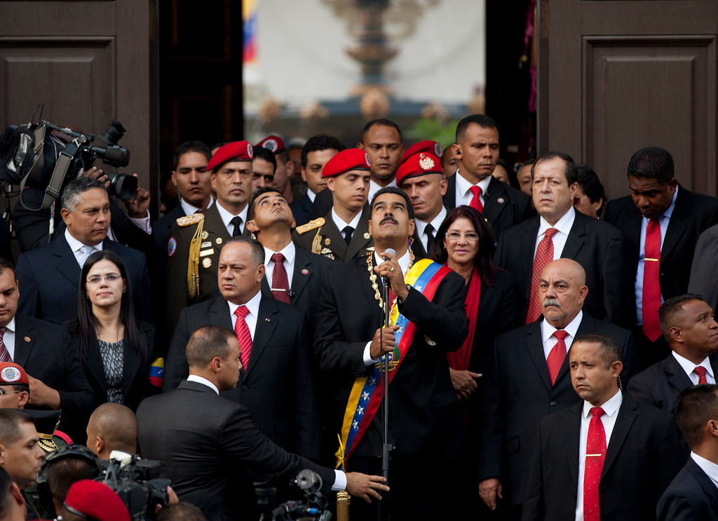 . Venezuela\'s newly sworn-in President Nicolas Maduro, center, looks up as he leaves the National Assembly after his swearing-in ceremony in Caracas, Venezuela, Friday, April 19, 2013. The opposition boycotted the swearing-in ceremony, hoping that the ruling party\'s last-minute decision to allow an audit of nearly half the vote could change the result in a the bitterly disputed presidential election. (AP Photo/Gil Montano)