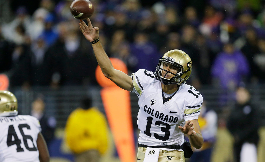 . Colorado quarterback Sefo Liufau passes in the first half of an NCAA college football game against Washington, Saturday, Nov. 9, 2013, in Seattle. (AP Photo/Ted S. Warren)