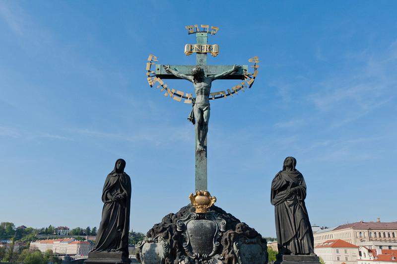 Statue of crucified Jesus Christ in Charles Bridge - Prague, Czech Republic