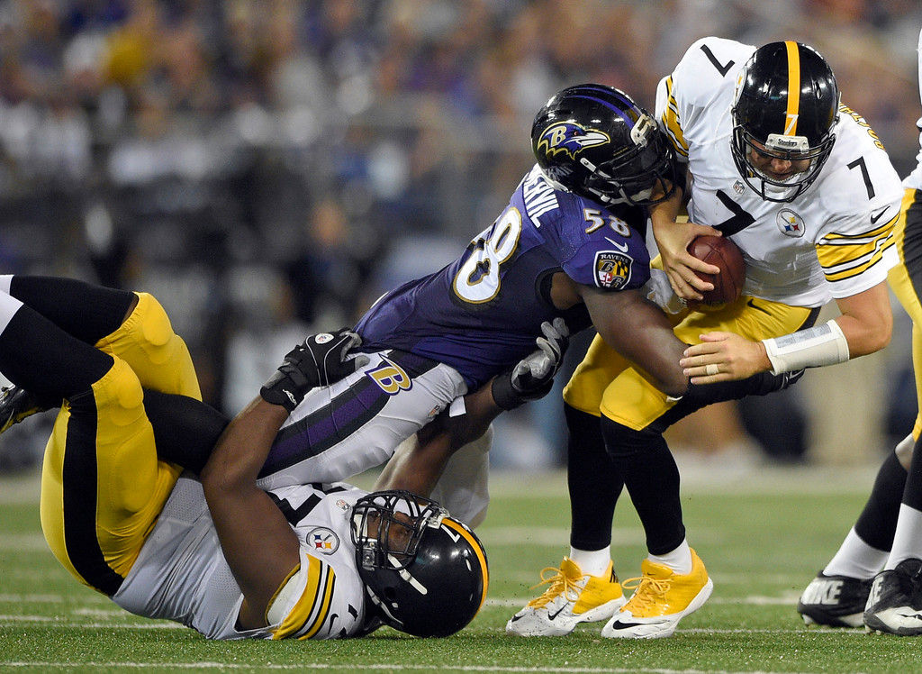. Baltimore Ravens outside linebacker Elvis Dumervil (58) sacks Pittsburgh Steelers quarterback Ben Roethlisberger (7) in spite of the blocking by tackle Marcus Gilbert (77) during the second half of an NFL football game Thursday, Sept. 11, 2014, in Baltimore. (AP Photo/Nick Wass)