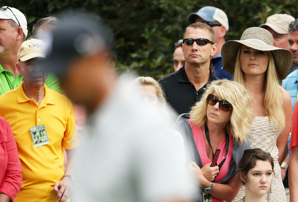 Description of . Skier Lindsey Vonn watches as boyfriend Tiger Woods of the United States plays the first hole during the first round of the 2013 Masters Tournament at Augusta National Golf Club on April 11, 2013 in Augusta, Georgia.  (Photo by Andrew Redington/Getty Images)