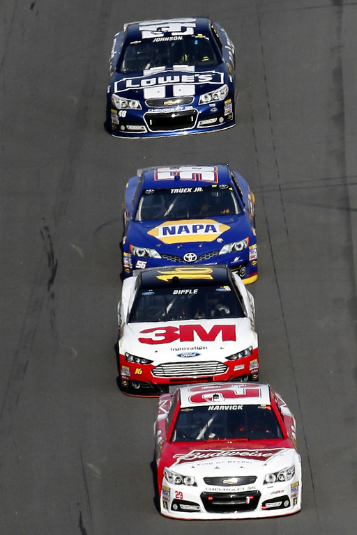 . Kevin Harvick, driver of the #29 Budweiser Chevrolet, leads Greg Biffle, driver of the #16 3M Ford, Martin Truex Jr., driver of the #56 NAPA Auto Parts Toyota, and Jimmie Johnson, driver of the #48 Lowe\'s Chevrolet, during the NASCAR Sprint Cup Series Budweiser Duel 1 at Daytona International Speedway on February 21, 2013 in Daytona Beach, Florida.  (Photo by Sam Greenwood/Getty Images)