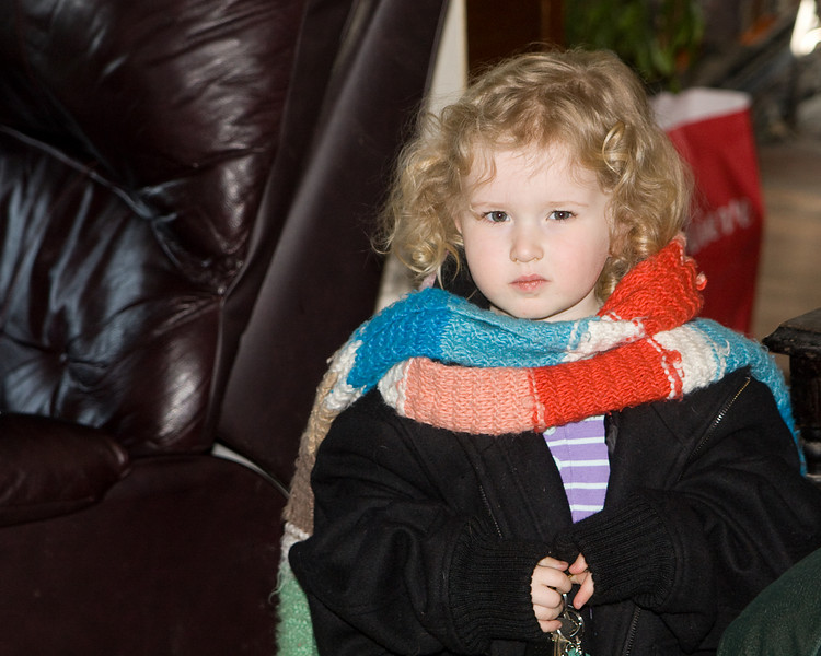 Beverly wearing Aunt Jenn's scarf and jacket and holding her keys