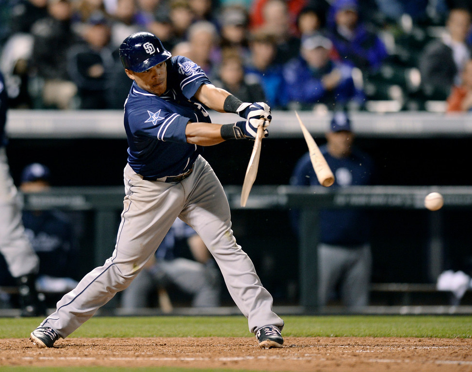 . DENVER, CO - MAY 15: San Diego batter Everth Cabrera broke his bat connecting with a ball in the seventh inning. The Colorado Rockies hosted the San Diego Padres at Coors Field  Friday night, May 16, 2014. (Photo by Karl Gehring/The Denver Post)