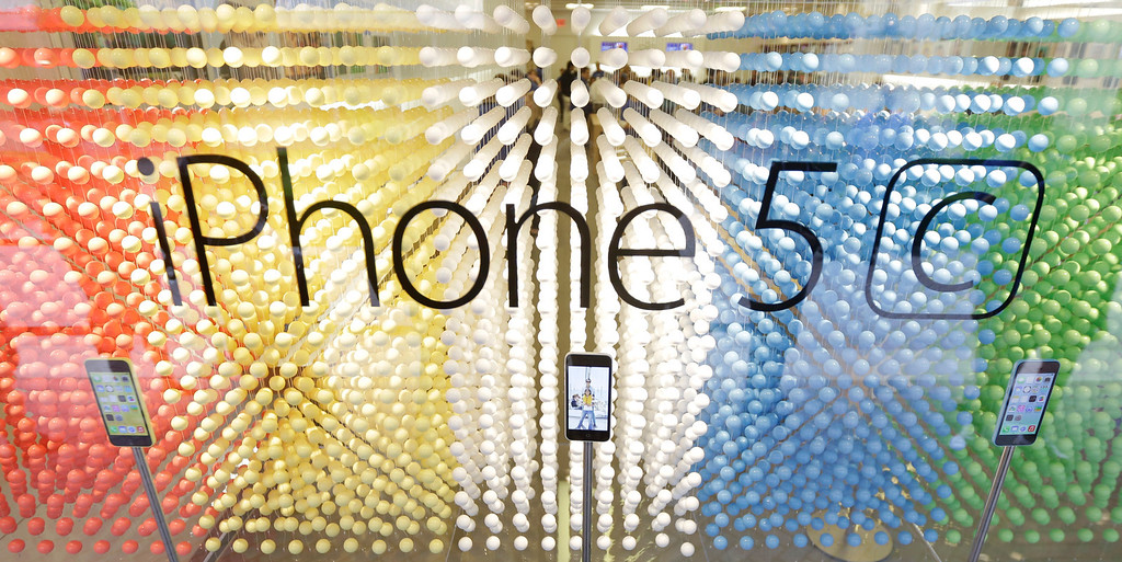 . A display of iPhone 5C\'s at an Apple store during the opening day of sale of the new phones in Richmond, Va., Friday, Sept. 20, 2013.  (AP Photo/Steve Helber)