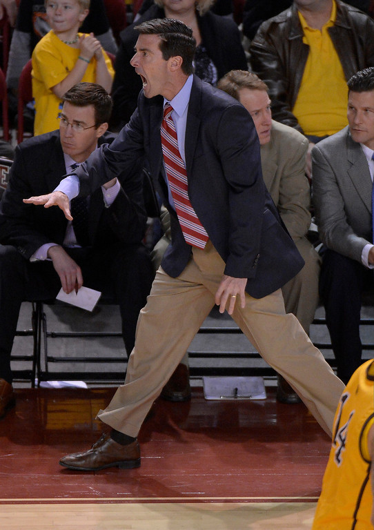 . Denver Pioneers head coach Joe Scott yells at the referee during the second half agains the Wyoming Cowboys December 15, 2013 Magness Arena. (Photo by John Leyba/The Denver Post)