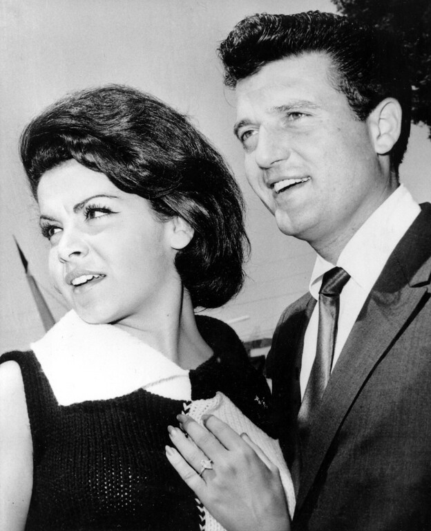 """. Former Mouseketeer Annette Funicello is seen on the set of the Walt Disney production \""""Pajama Party,\"""" with motion picture agent Jack Gilardi, shortly after the couple announced their plans to marry, in Hollywood, Calif., on August 24, 1964.    (AP Photo)"""