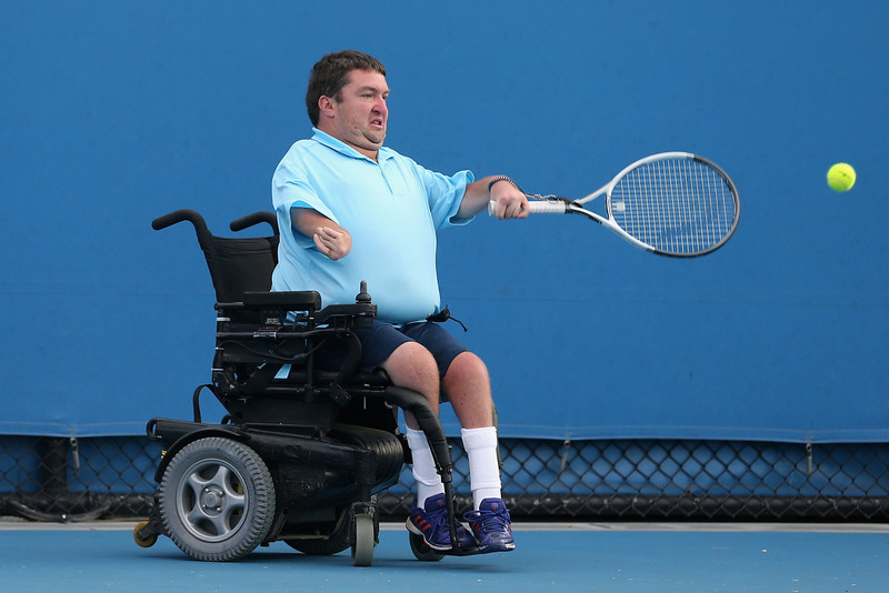. Nicholas Taylor of the United States of America plays a forehand in his Quad Wheelchair Doubles Final match with David Wagner of the United States of America against Anders Hard of Sweden and Andrew Lapthorne of Great Britain during the 2013 Australian Open Wheelchair Championships at Melbourne Park on January 25, 2013 in Melbourne, Australia.  (Photo by Scott Barbour/Getty Images)