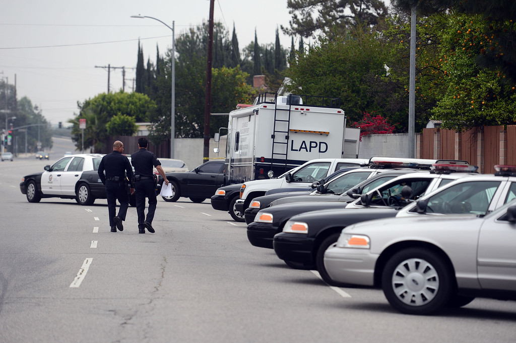 . Los Angeles Police at the scene of a missing girl in the 8400 Blk of Oakdale Av Wednesday, March 27, 2013. Nicole Ryan, 10-years-old, was last seen by her mother in her bedroom at 1am. At 4am the mother found Nicole\'s room empty with the backdoor unlocked and the side gate open. Officals say Nicole is unable to reach the lock on the side gate without assistance. (Hans Gutknecht/Staff Photographer)