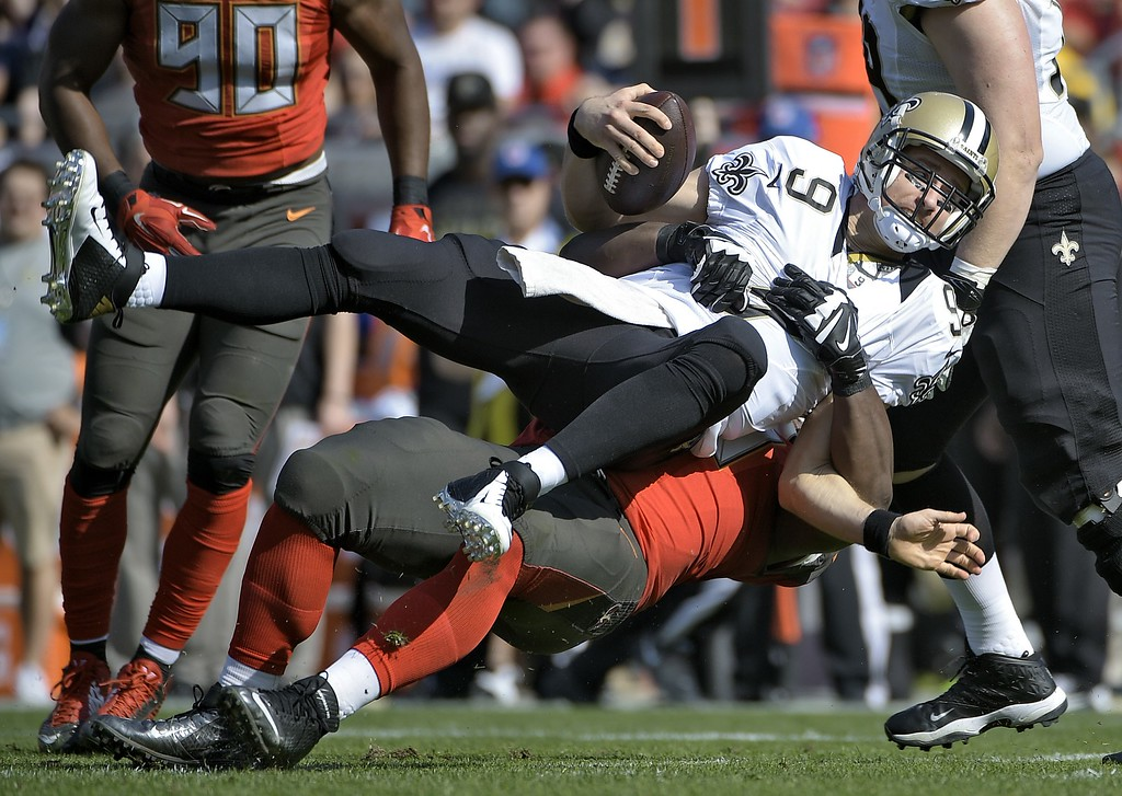 . New Orleans Saints quarterback Drew Brees (9) is sacked by Tampa Bay Buccaneers defensive tackle Clinton McDonald (98) during the second quarter of an NFL football game Sunday, Dec. 28, 2014, in Tampa, Fla. (AP Photo/Phelan M. Ebenhack)
